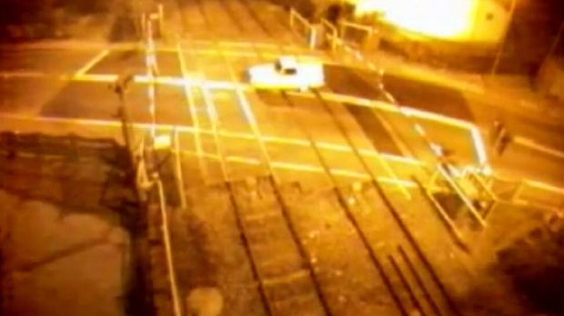 Screen grabbed image taken from video issued by British Transport Police of a Robin Reliant crashing through a level crossing in Nottinghamshire (British Transport Police/PA)