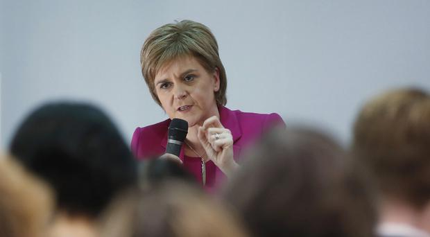 Speaking in Hong Kong, Nicola Sturgeon said 'time will tell' if there is another Scottish independence referendum before 2020 (AP)
