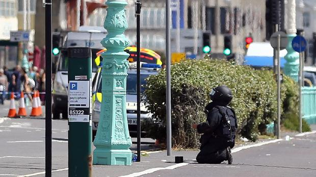 A bomb disposal expert prepares to carry out a controlled explosion in Brighton after a suspect package was found before the annual Pride parade