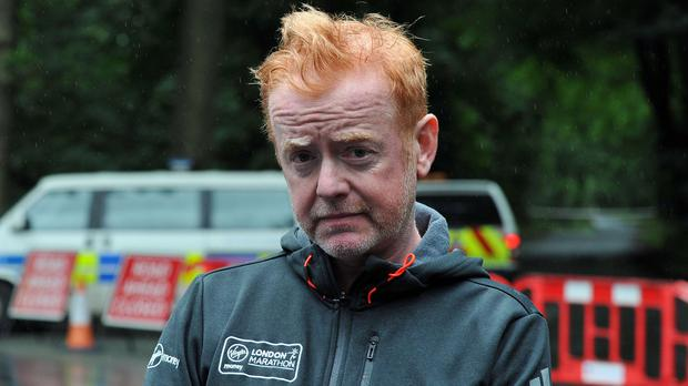 Chris Evans speaks to the media after a display aircraft plummeted to the ground at the CarFest event, killing the pilot