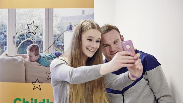 Wayne Rooney meeting NSPCC young campaigner Kimberley, 18, in Manchester (NSPCC)