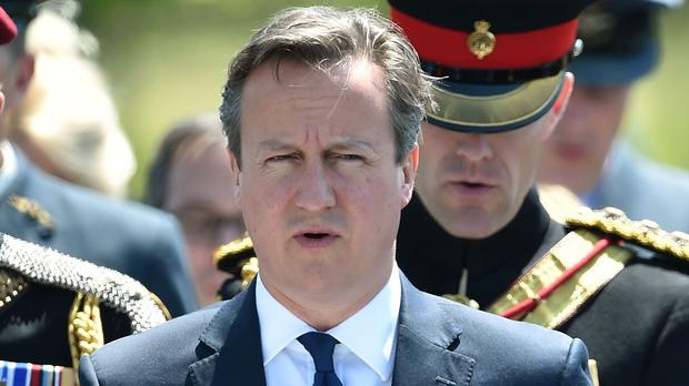 David Cameron says a timetable towards the publication of the Chilcot Inquiry should be set out