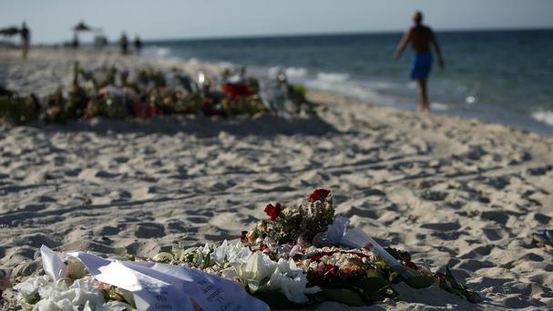 Tributes remain on the beach in Sousse, where 38 tourists were killed by a gunman in June