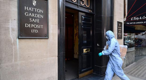 A police forensics officer entering the Hatton Garden Safe Deposit company in London after the raid