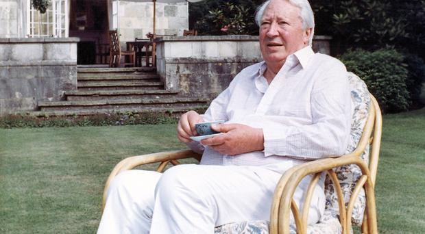 Edward Heath drinking tea in the garden of his home in Salisbury (AP)