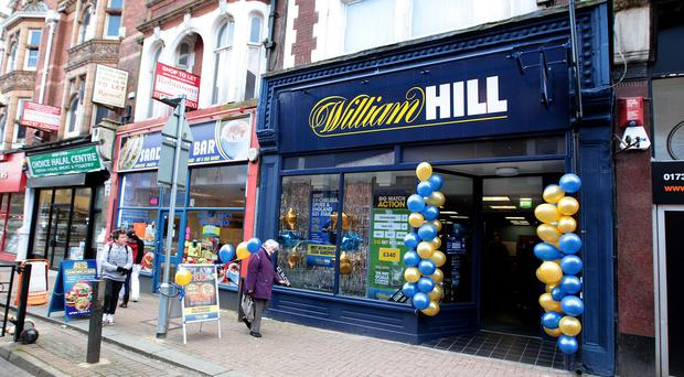 William Hill is moving into the online lotteries market with the purchase of a stake in US-focused business NeoGames