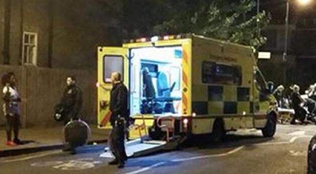 Riot police officers by an ambulance in Stoke Newington after a 400-strong masked mob attacked police with bottles and bricks after a party spiralled out of control (@Ajmanutd10/PA Wire)