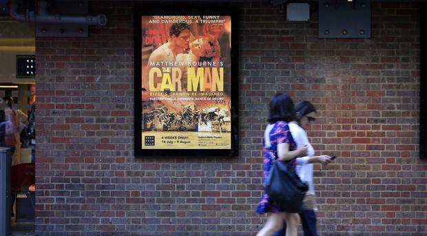 A poster advertising Matthew Bourne's The Car Man at Sadler's Wells Theatre, London, which was cancelled following the death of dancer Jonathan Ollivier
