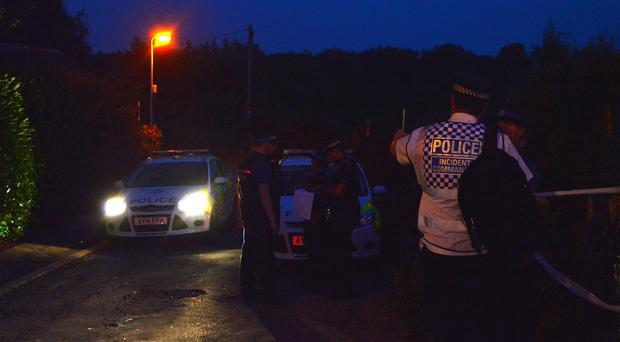 A police cordon in Trowse, Norfolk, near the scene where the teenagers died