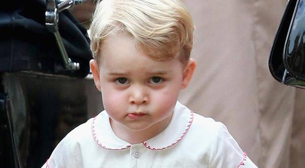 Prince George at Princess Charlotte's christening at the Church of St Mary Magdalene in Sandringham, Norfolk