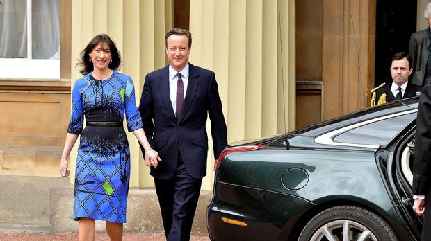 David Cameron leaves Buckingham Palace after winning a second term as Prime Minister