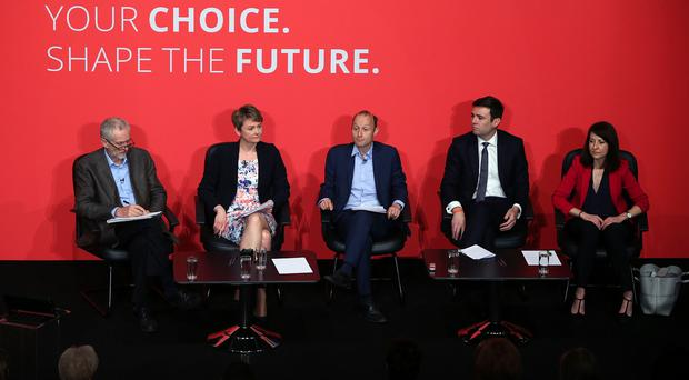 Jeremy Corbyn (left), Yvette Cooper (2nd left), Andy Burnham (2nd right) and Liz Kendall (right) take part in a Labour Party leadership hustings, moderated by Paul Waugh (centre), at Parr Hall, Warrington, Cheshire.