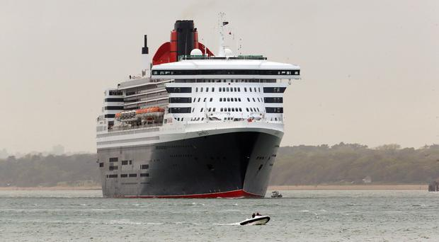 The Queen Mary 2 is searching off Canada for a crew member who went overboard