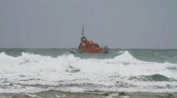 The coastguard and police carried out a rescue operation when four children and three adults got into difficulty at Mawgan Porth beach in Cornwall (Screengrab/PA)