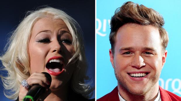 Oliver and Amelia were the most popular names given to babies born in England and Wales last year. Pictured are Amelia Lily and Olly Murs