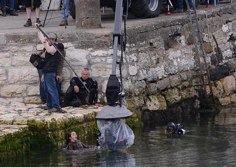 Game of Thrones actress Maisie Williams who plays Arya Stark gets into the sea during filming at Carnlough yesterday