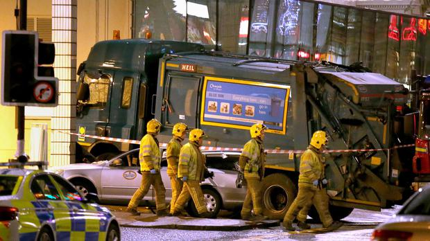 Six people died after a bin lorry veered out of control and mounted a pavement on Queen Street
