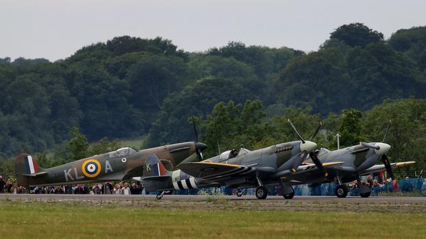 World War II Spitfires prepare to take to the skies at Biggin Hill Airfield in Kent