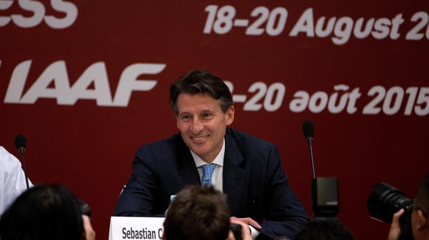 Newly-elected IAAF president Sebastian Coe smiles to photographers as he arrives on stage for a press briefing at the IAAF Congress at the National Convention Centre in Beijing (AP)