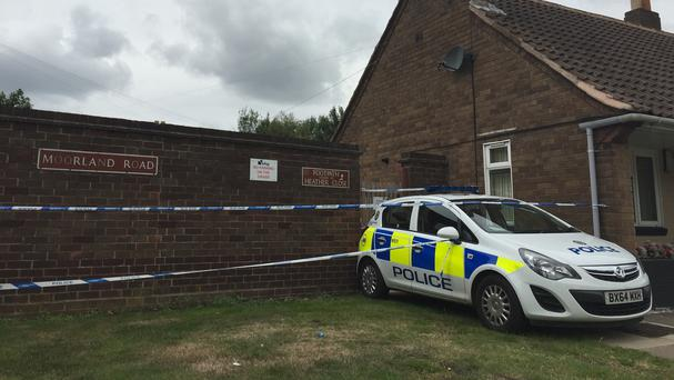 A police car is parked outside a house in Heather Close, Walsall, after the body of a woman with learning difficulties was found