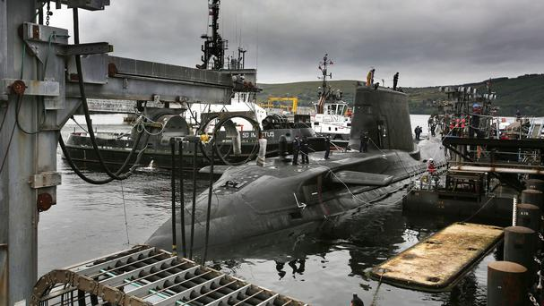 Artful, Britain's latest nuclear-powered submarine arrives at its new home on the Clyde in Scotland