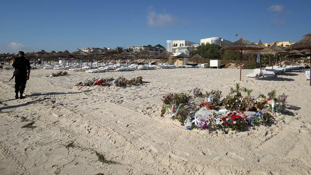 Flowers on the beach in Sousse following the massacre of 38 tourists