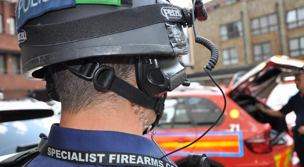 A police officer wearing a helmet mounted camera (Metropolitan Police)