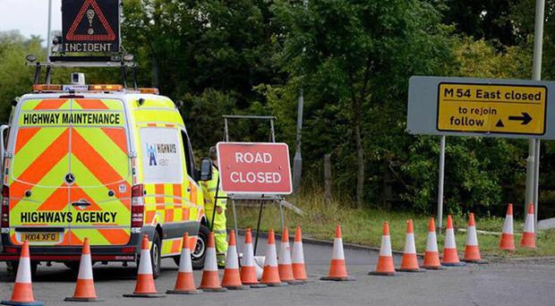 The road closure at junction 4 of the M54 where a skull was found on the embankment. (PA/West Midlands Emergency Alerts)
