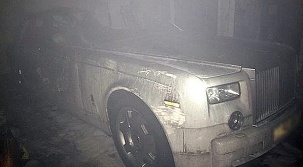 A luxury Rolls Royce Phantom after the suspected arson attack