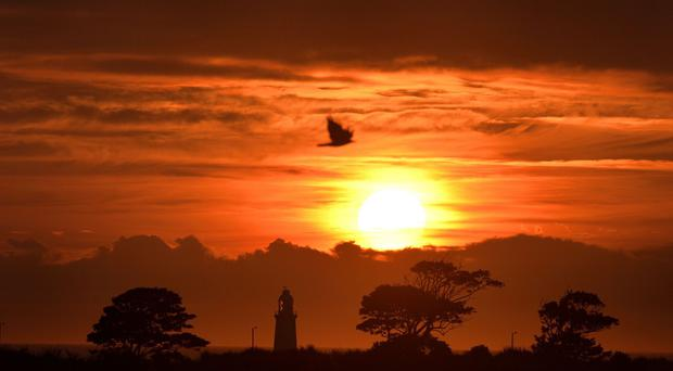 The sun rises over Whitley Bay with the top of St Mary's lighthouse visible, as the country comes under a