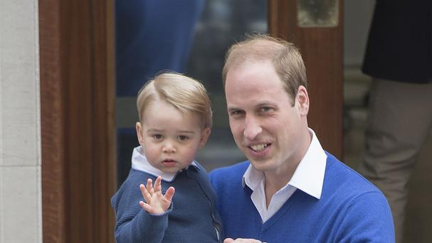 The Duke of Cambridge, pictured with his son Prince George, praised the Queen's public service and role in his family