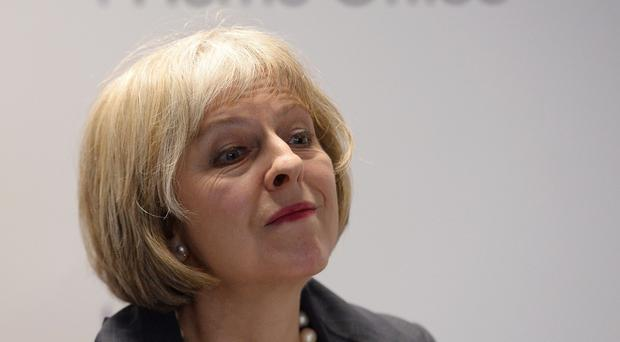 Home Secretary Theresa May is to review a charity's recommendations on appropriate adults