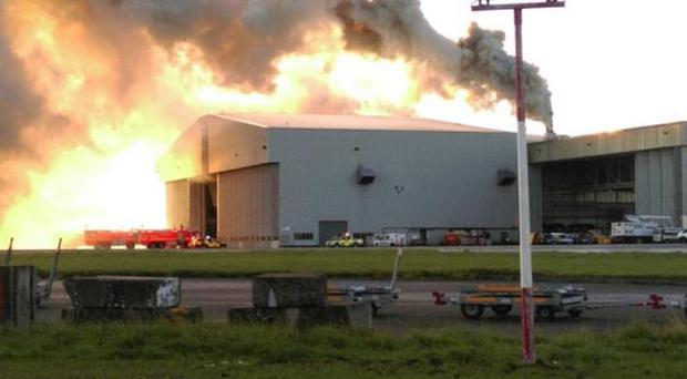 Flights are suspended after a fire in a hangar at Dublin Airport. (Picture: @dubfirebridade)