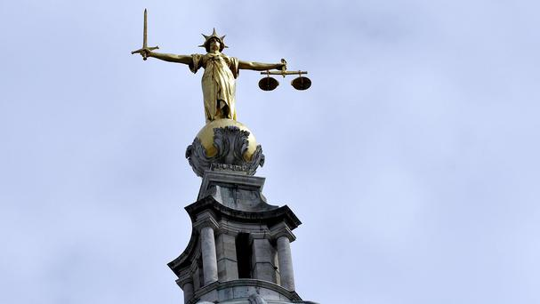 A woman accused of operating a charity scam to steal from elderly victims had £100 hidden in her bra, the High Court has heard
