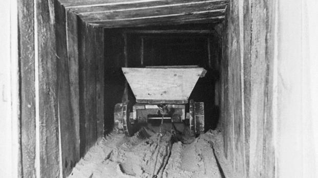 A trolley in the 'Harry' escape tunnel originally built by Allied airmen at the German Stalag Luft III prisoner of war camp, in Poland (Channel 4)