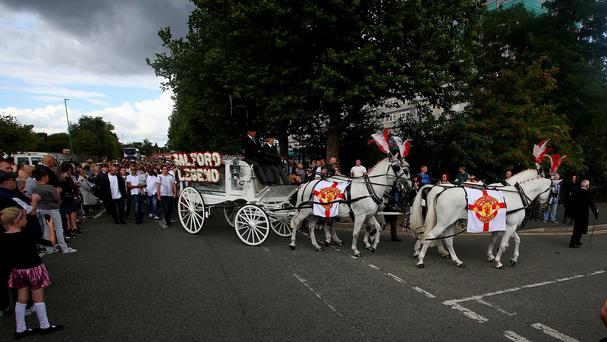 A horse-drawn hearse carries the coffin of Paul Massey who was shot at his Salford home
