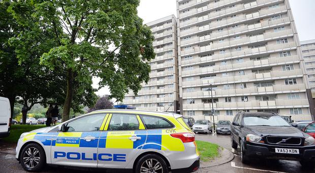 A police car parked outside Picardy House in Cedar Road, Enfield, where police shot a man dead