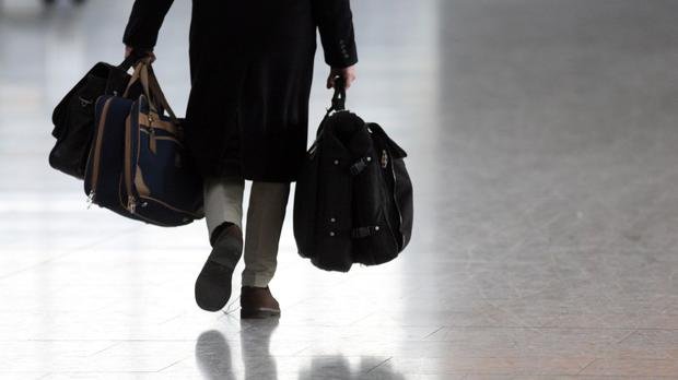 A benefits cheat was seen moving freely with luggage through an airport