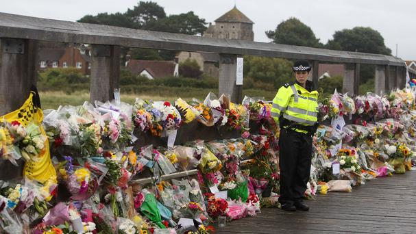 Floral tributes are left on a bridge near the A27 at Shoreham in West Sussex, close to the scene of the Shoreham air disaster
