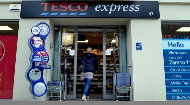 Tesco has reduced the rewards it offers to 2.8 million credit card customers, blaming the EU cap on interchange fees