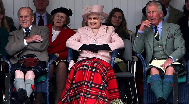 The Duke of Edinburgh, the Queen and the Prince of Wales attended last year's Braemar Gathering