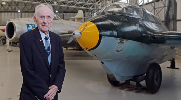 Captain Eric Brown with the rocket-powered Komet he flew to Britain from Germany at the end of the Second World War (Neil Hanna/National Museum of Flight/PA Wire)