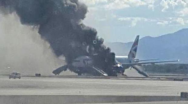 Passengers and crew fled the aircraft after an engine burst into flames