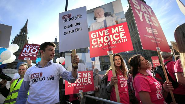 Protesters on opposing sides of the assisted dying debate, outside the Houses of Parliament in London as MPs debate and vote on the Assisted Dying Bill
