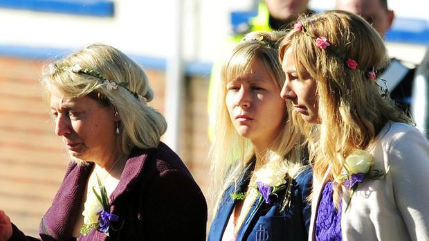 Hannah Witheridge's mother Sue (left) arrives with her daughters, Laura (centre) and Tania at her daughter Hannah's funeral service last year