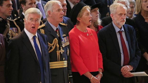 Jeremy Corbyn, right, stands as the national anthem is sung during a service at St Paul's Cathedral