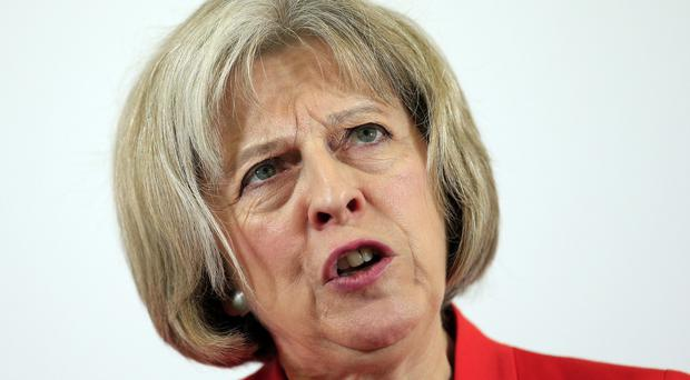Home Secretary Theresa May told the Commons a group of Syrian refugees would arrive in the UK 'in the coming days'