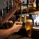 Moderate drinkers were more protected against heart attacks than either light or heavy drinkers