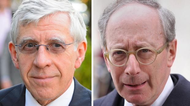 Jack Straw, left, and Sir Malcolm Rifkind did not breach paid lobbying rules, a watchdog found