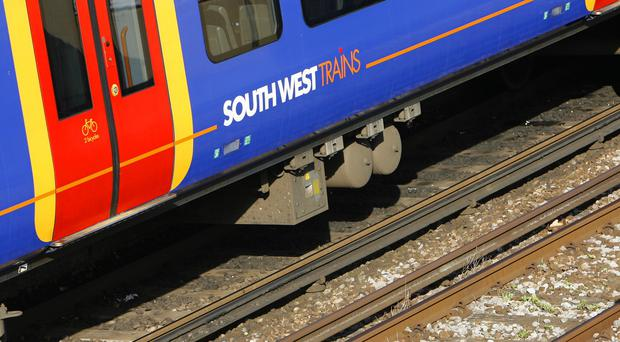 South West Trains said services were being delayed because a customer had had an accident at Twickenham station